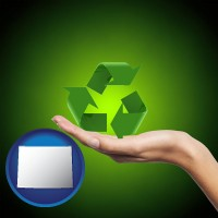 wyoming map icon and a recycling symbol
